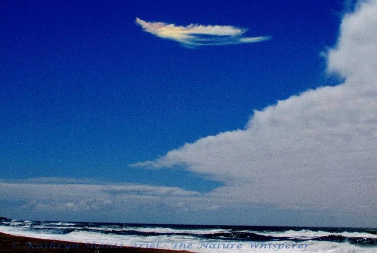 Rainbowl Angel above ocean